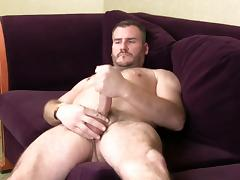 Horny gay hunk masturbates on an interview porn tube video