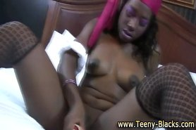Teen black bitch uses toy