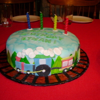Train   White cake with fondant decorations