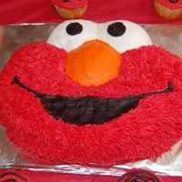 "And Yet...another Elmo!! made for dd's 2nd b-day. wilton pan (duh-lol) a gallon drum of 'no taste' red, and grass tip 266 to get the ""real fur&..."