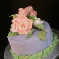 Roses Birthday cake for client. Yellow vanilla cake with lemon mousse filling. Fondant with buttercream frosting and GP roses and fantasy flowers...