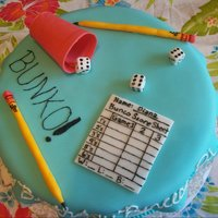 Bunko Chocolate Chocolate Chip Cake with vanilla buttercream. Fondant accents and royal icing